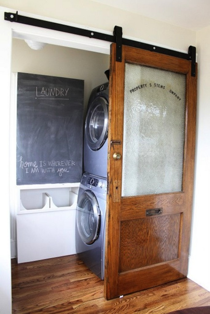 This windowed door is ideal for the laundry room.  Thanks to homejelly.com for this unique look.