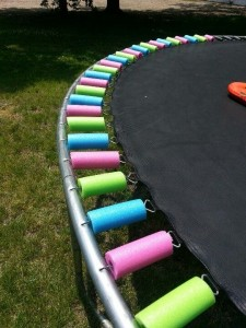 Wrap trampoline springs with pool noodles Fun & Festive!
