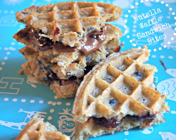 Nutella Waffles Sandwich bites with yogurt for dipping.