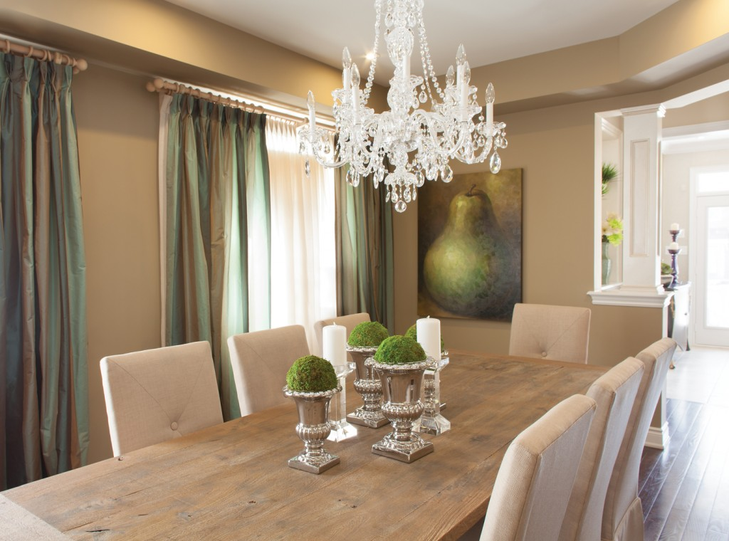 The drapes in this Cardinal Point model home add a dramatic effect to the Dining Room.