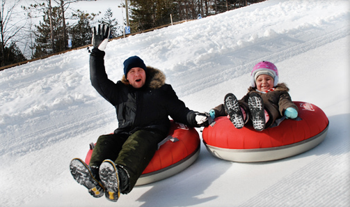 Take in some extreme or unique winter sports and activities like Snow Tubing!