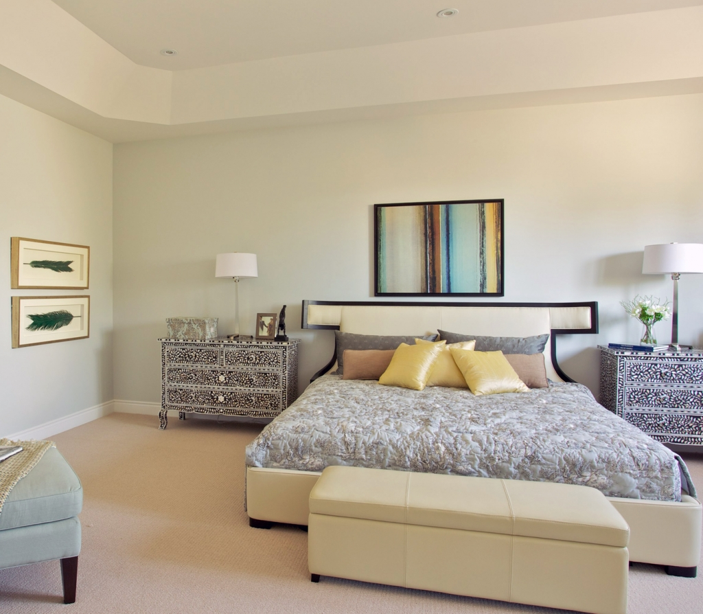 The upholstered headboard adds a soft, classic vibe to the master bedroom in Forest Trails.